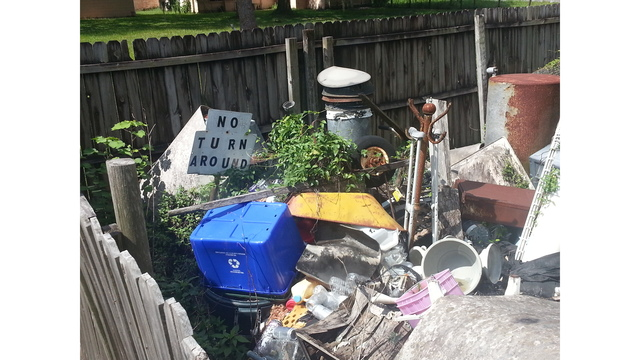 Hillsborough demands payment for clearing property filled with trash_119646