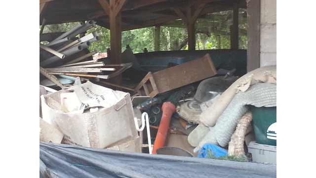 Hillsborough demands payment for clearing property filled with trash_119647