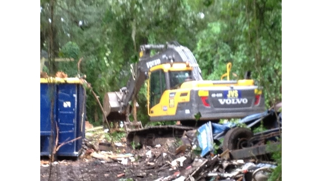 Hillsborough demands payment for clearing property filled with trash_119648