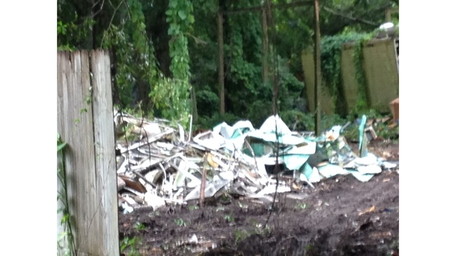 Hillsborough demands payment for clearing property filled with trash_119649