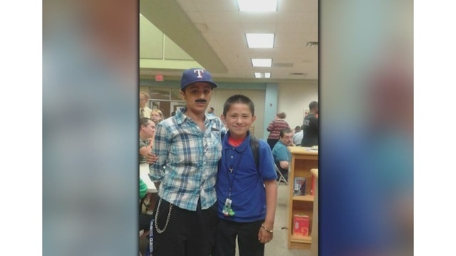 Single-mom dresses like a man for son's 'Donuts with Dad' day