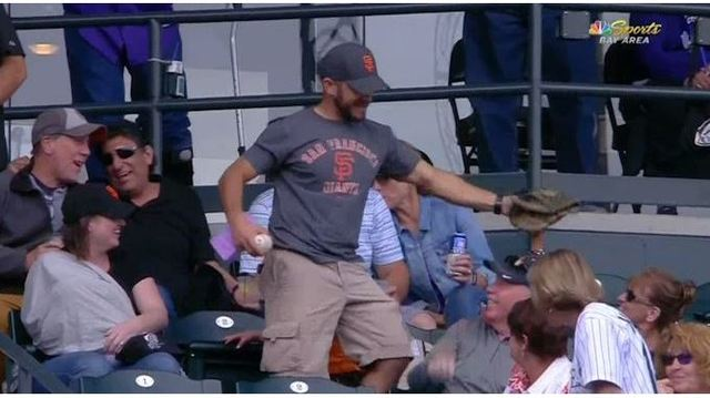 Dad falls over kid to catch foul ball at MLB game
