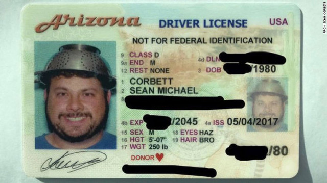 Man wears pasta strainer on his head in driver's license photo