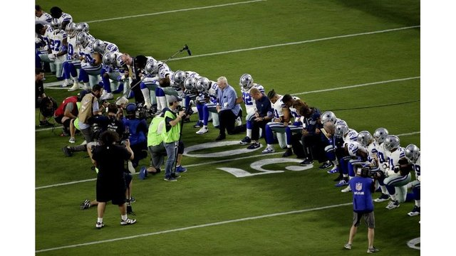 Cowboys kneel, but before the national anthem