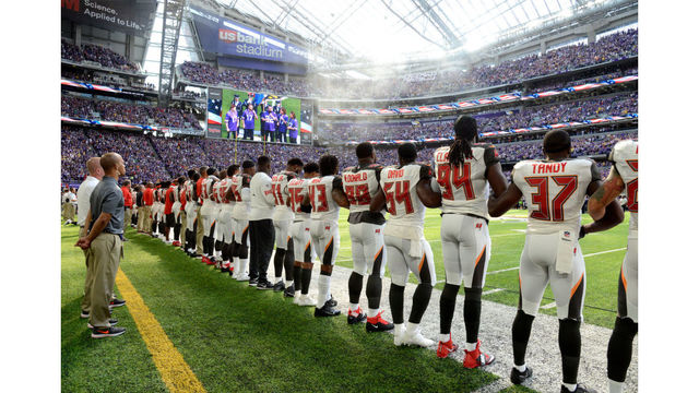 Is there NFL rule requiring players to stand for National Anthem?