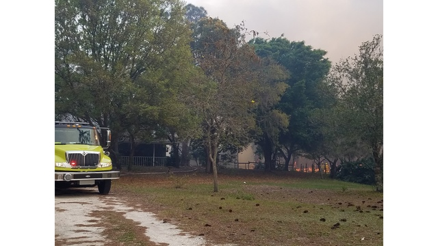 Strong wind shift fans previously contained, 220-acre brush fire in Highlands County