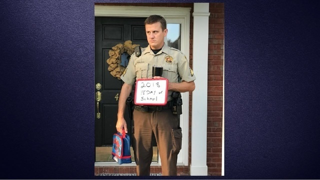 SRO reluctantly poses for back-to-school picture