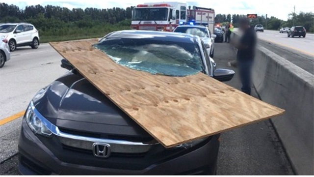 Florida driver escapes unscathed after plywood impales windshield