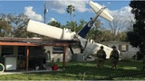 Flight instructor killed, 7 miraculously survive after plane crashes into home